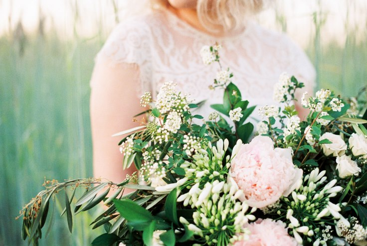 sophisticated floral designs portland oregon florist bouquet with peony spirea roses and olive branch