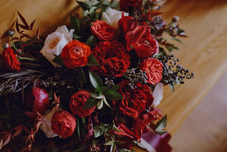 dark and moody wedding bouquet burgundy and navy wedding flowers by sophisticated floral designs portland oregon
