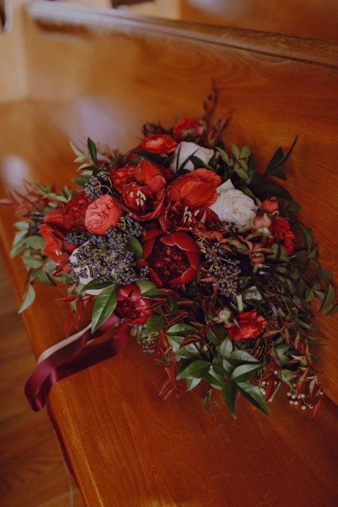 dark and moody bridal bouquet jewel toned sophisticated floral designs