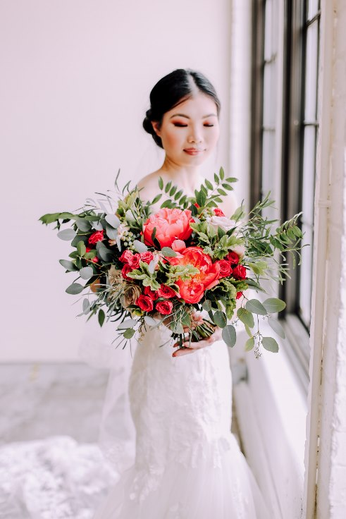 sophisticated floral designs portland wedding florist elegant bridal bouquet with peonies 2019 color of the year living coral