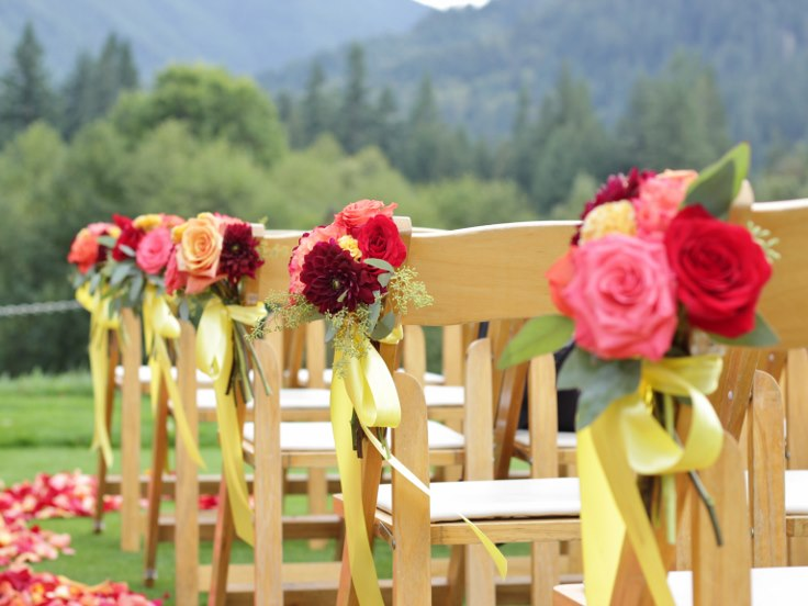 sophistiated floral designs portland oregon wedding florist flowers down the aisle chair flowers