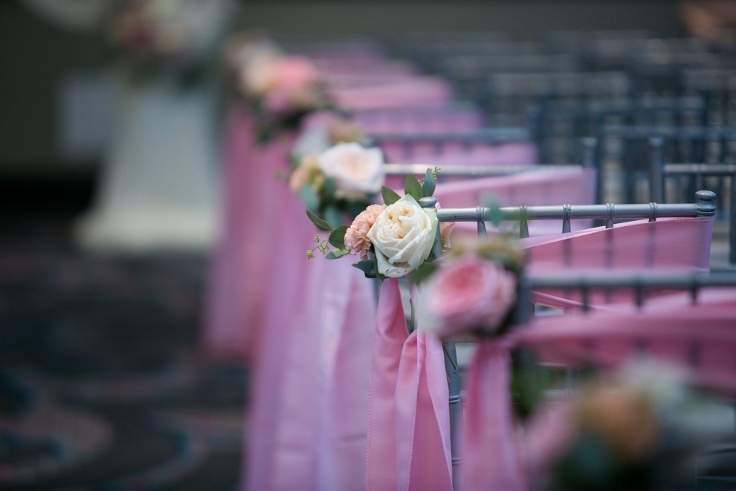 sophisticated floral designs portland oregon wedding florist Nines Hotel chair sash flowers