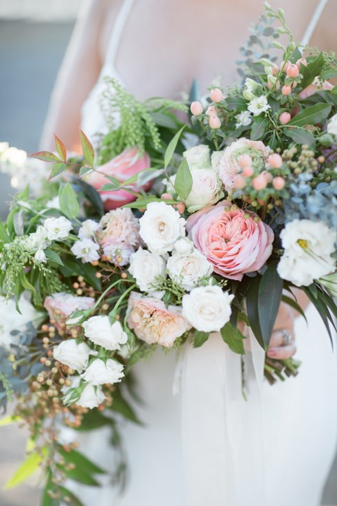 sophisticated floral designs portland oregon wedding florist blush oversized boho bridal bouquet ranunculus garden roses (5).jpg