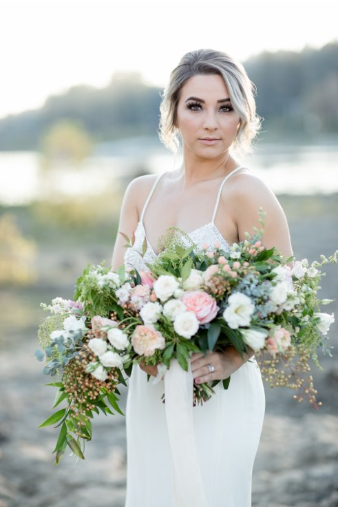 sophisticated floral designs portland oregon wedding florist blush oversized boho bridal bouquet ranunculus garden roses (8).jpg