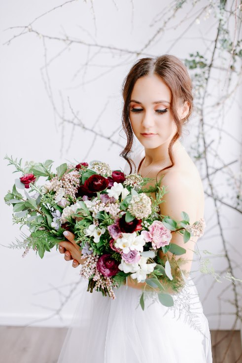 sophisticated floral designs portland oregon wedding florist spotted stills photography plum and mauve ranunculus bouquet (14).jpg