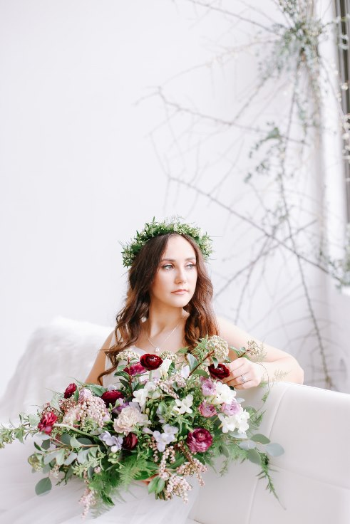 sophisticated floral designs portland oregon wedding florist spotted stills photography plum and mauve ranunculus bouquet bridal greenery floral crown bridal