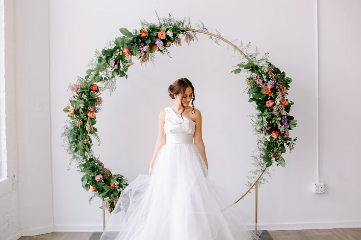 sophisticated floral designs portland oregon wedding florist floral hoop round arbor moon gate arch (11).jpg