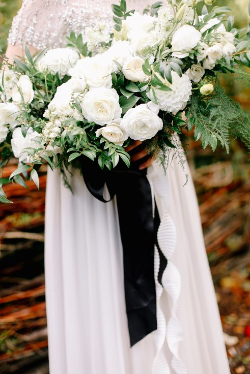 sophisticated floral designs portland oregon wedding florist mcmenamins edgefield spotted stills photography large lush greenery and white dahlia bridal bouquet