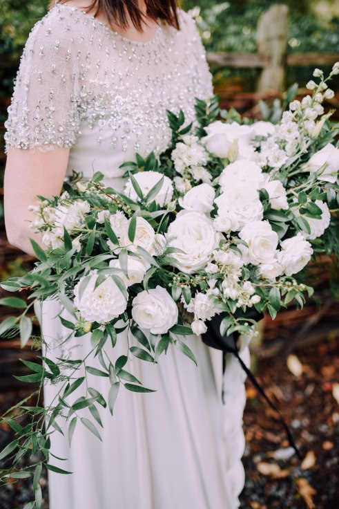 sophisticated floral designs portland oregon wedding florist mcmenamins edgefield spotted stills photography large white  bridal bouquet