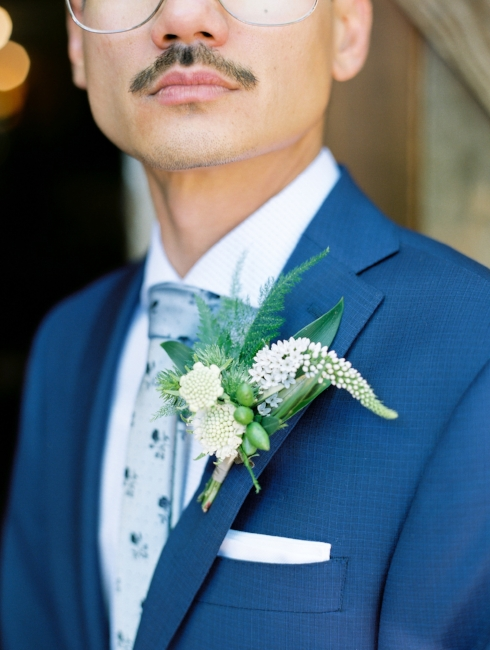 sophisticated floral designs Mcmenamins Roadhouse navy suit wedding groom boutonneire