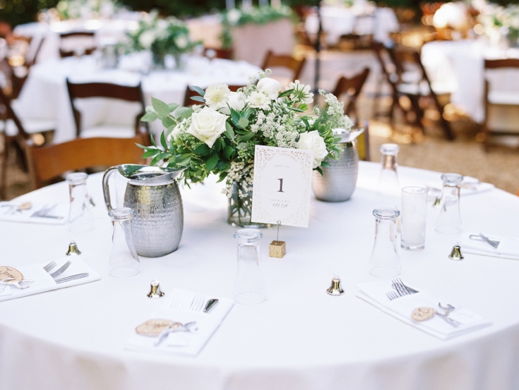 sophisticated floral designs Mcmenamins Roadhouse wedding centerpieces with greenery