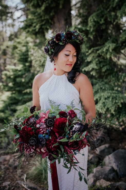 sophisticated floral designs portland oregon wedding florist powers photography mt hood wedding ski bowl black dark moody burgundy bridal bouquet and floral crown