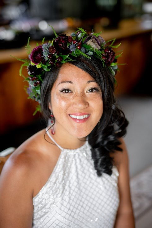 sophisticated floral designs portland oregon wedding florist powers photography mt hood wedding ski bowl black dark moody burgundy floral crown head wreath with plum ranunculus