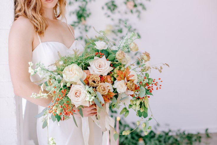 sophisticated floral designs portland oregon wedding florist fall wedding spotted stills photography greenery floral wall installation muted pale yellow tan peach bouquet fine art boudoir