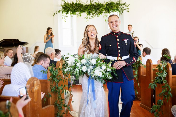 sophisticated floral designs portland oregon wedding florist military wedding bell tower chapel greenery floral installation greenery aisle decor