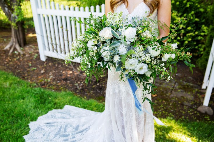 sophisticated floral designs portland oregon wedding florist military wedding bell tower chapel slate blue bridal bouquet with spring flowers lilac spirea peonies ranunculus