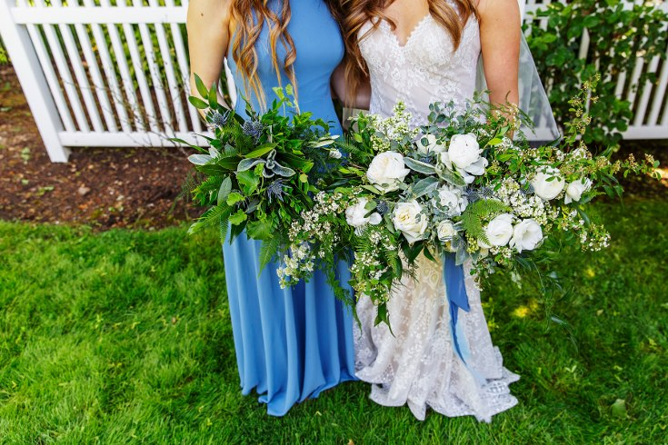 sophisticated floral designs portland oregon wedding florist military wedding bell tower chapel slate blue bridal bouquet with spring flowers lilac spirea peonies ranunculus all greenery bridesmaid bouquet