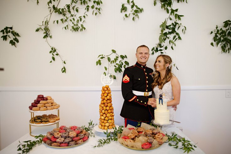 sophisticated floral designs portland oregon wedding florist military wedding bell tower chapel greenery vines wall installation dessert donut table