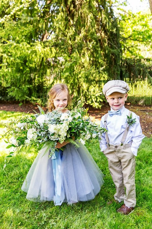sophisticated floral designs portland oregon wedding florist military wedding bell tower chapel flower girl holding bridal bouquet and ring bearer