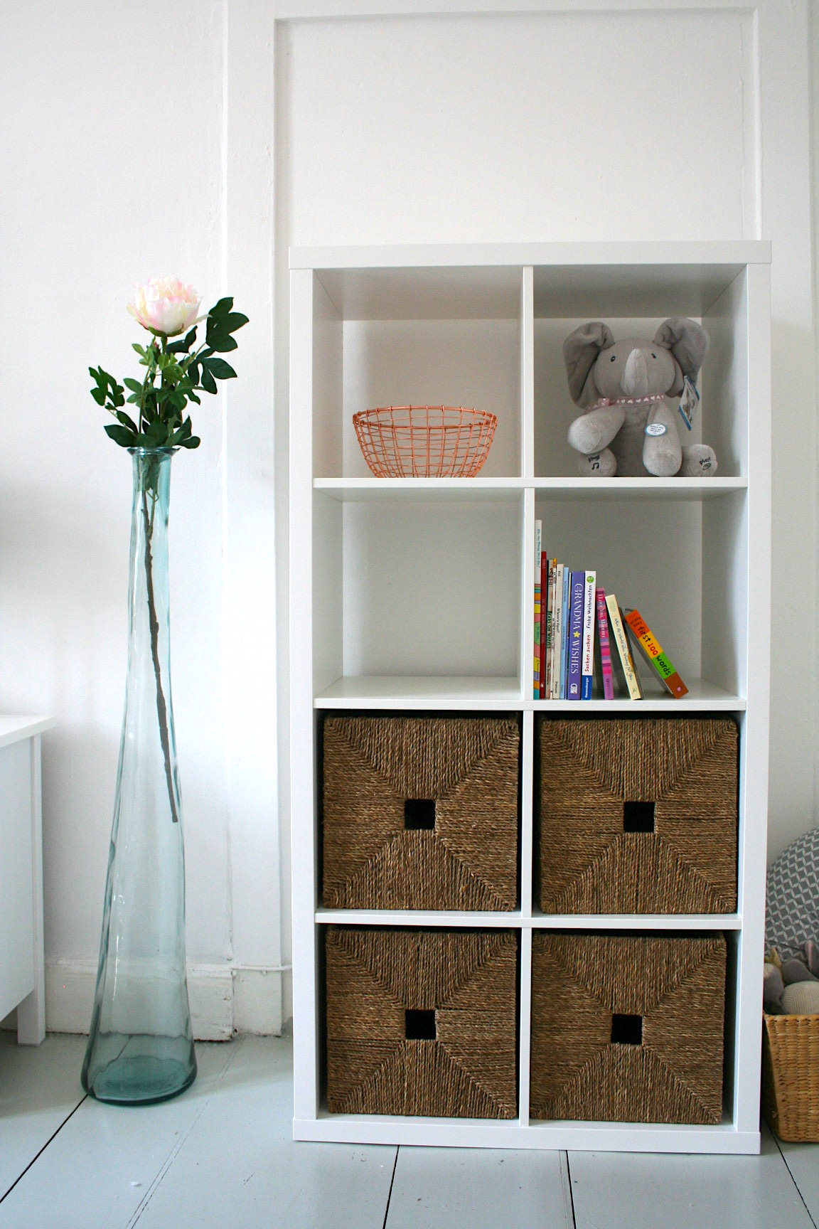Cute little bookcase from Ikea - Which has some great storage space since this room does not have any closet storage.Its next to our daybed which helps to also make this a guest room. (The daybed actually pulls out to be a queen sized bed!). Once again thankful for the storage space underneath.