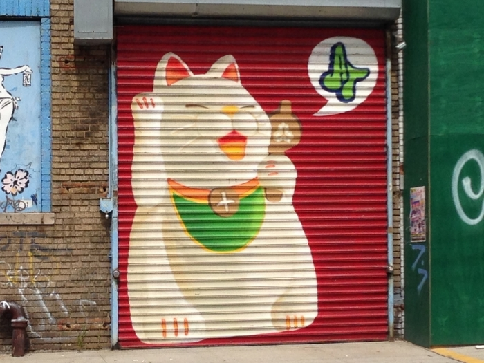 Maneki-neko is a Japanese figurine that symbolizes good luck--something we all need.  I love this graffiti version in Bushwick.
