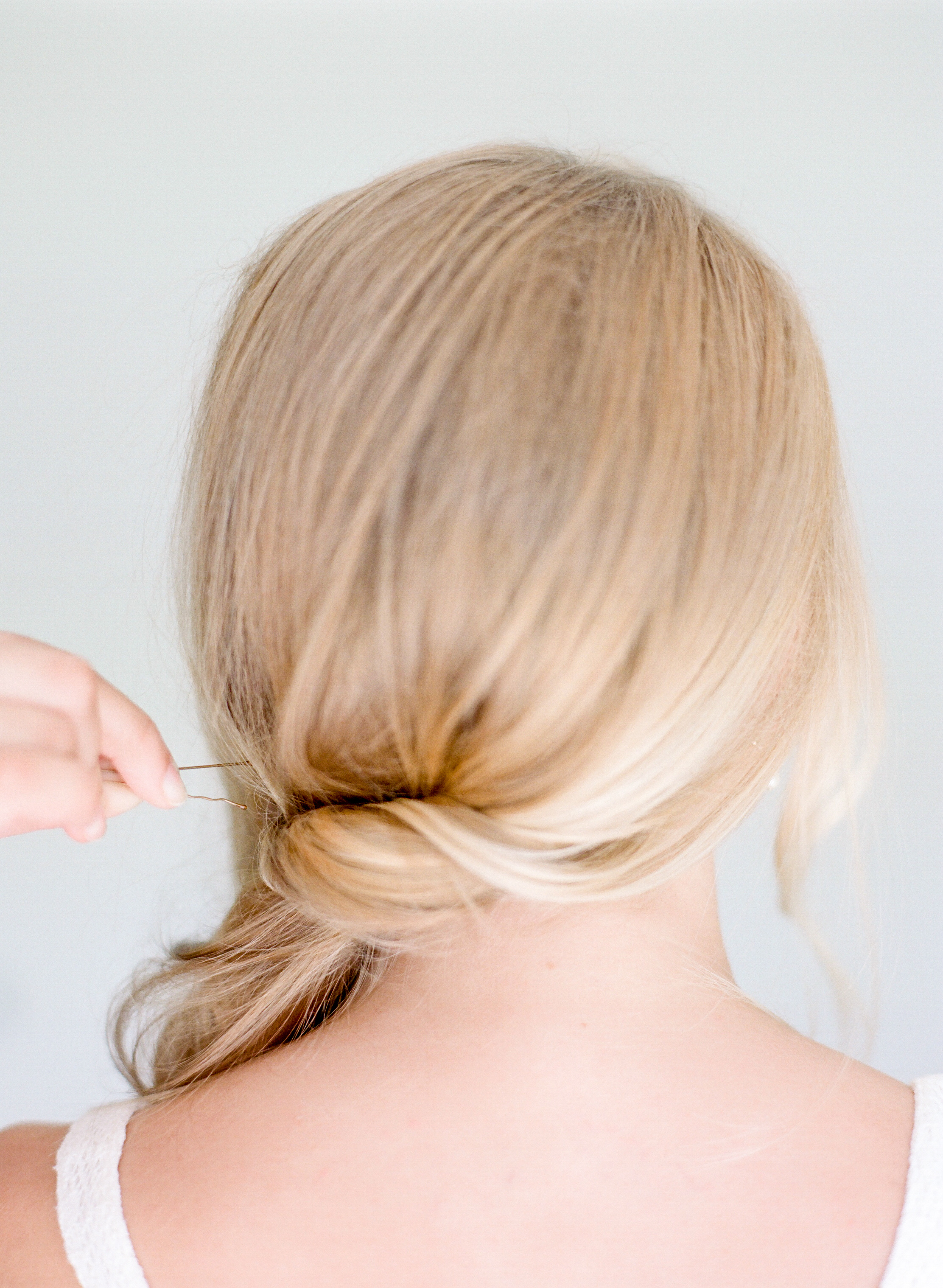 STEP TWO | Sweep hair to one side twisting from the bottom