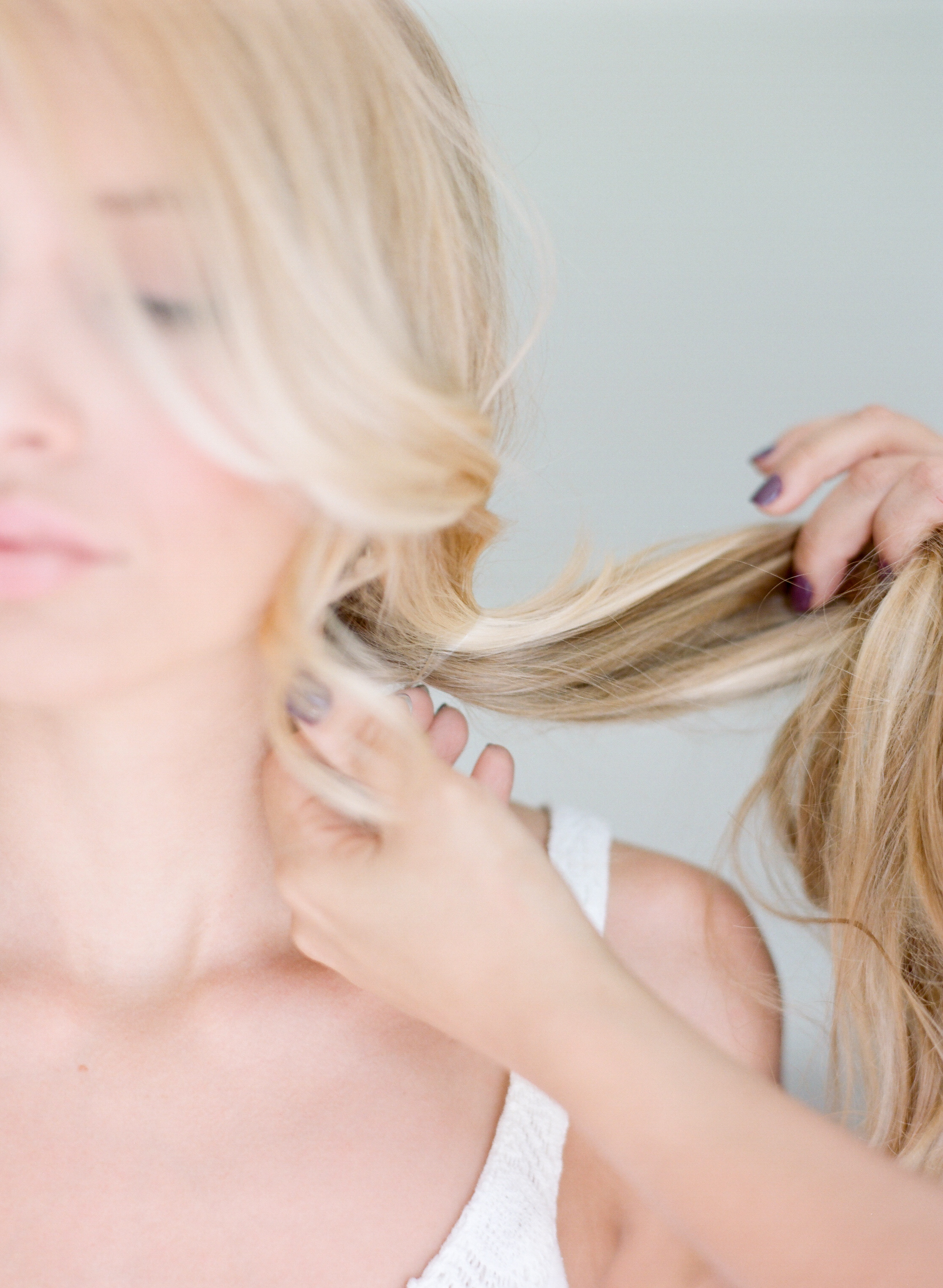 STEP ONE | Gather hair in a clear elastic slightly off center