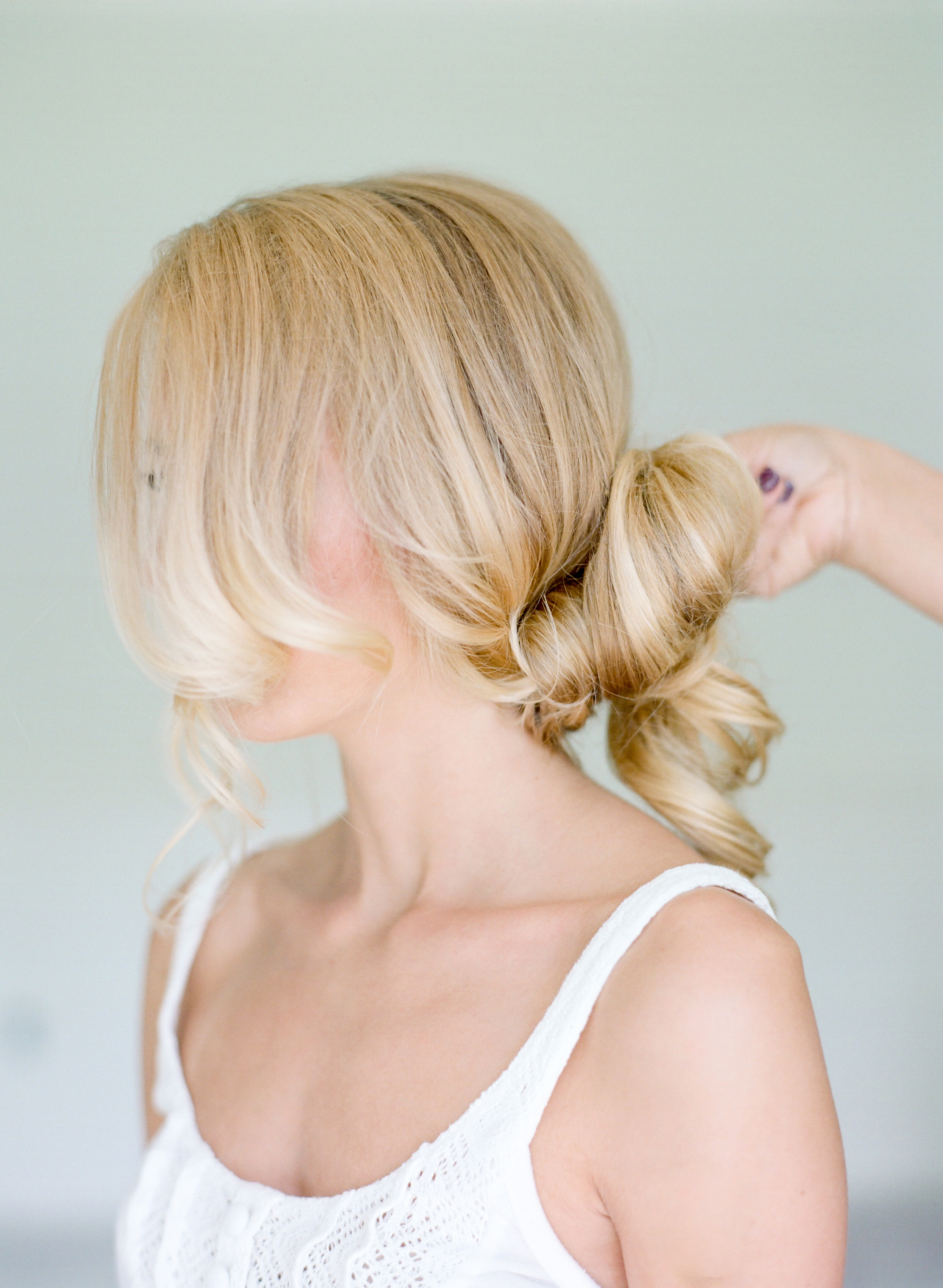 STEP THREE | Continue to twist and begin forming a bun around the clear elastic