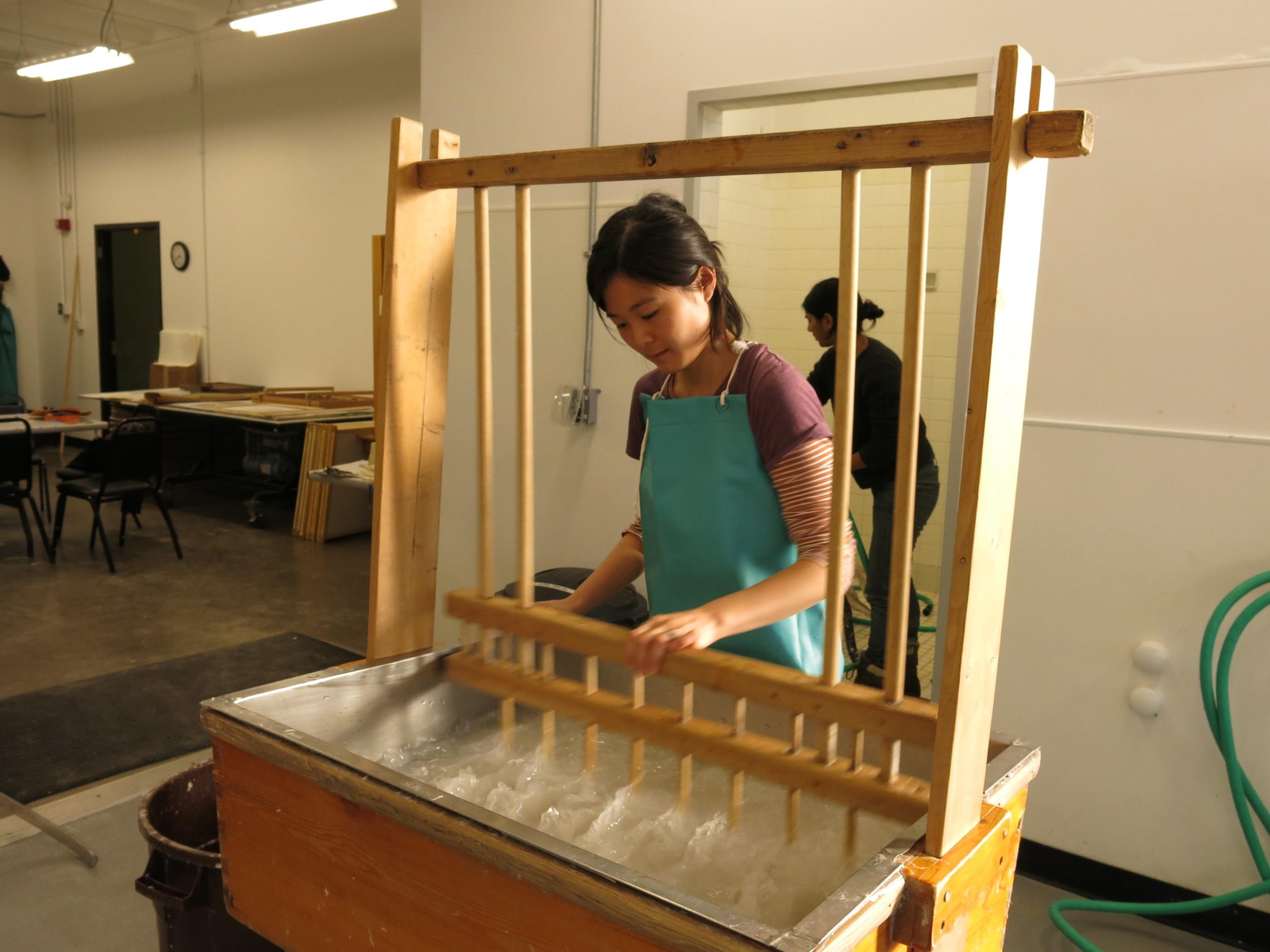 Steph charging the vat.