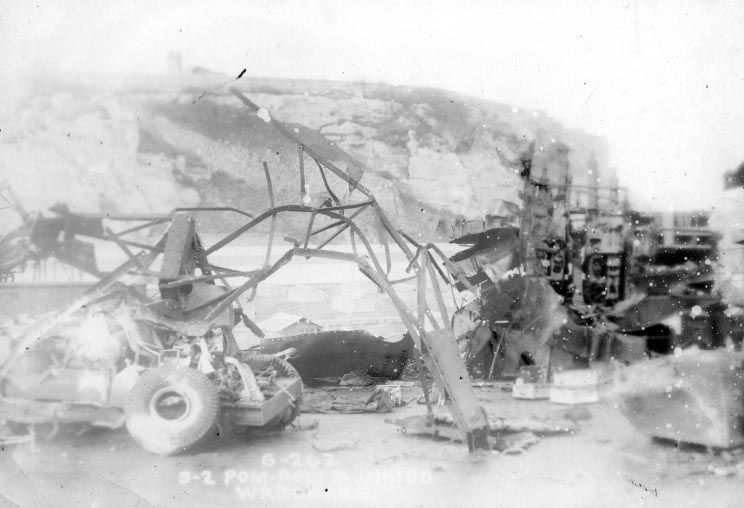 """The tangled mess that wasthe mobile 'Jumbo' crane after being lifted off the """"S1"""" PomPom. The shattered remains of """"S2"""" PomPom is to the right."""