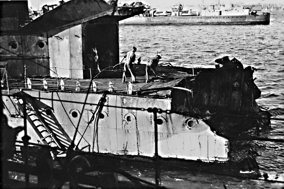 "Tail-end Charlie ... HMS Nubian in Alexandria Harbour after losing her stern to a bomb while on the screen for HMS Formidable. Another ""N""-class destroyer is passing in the background."