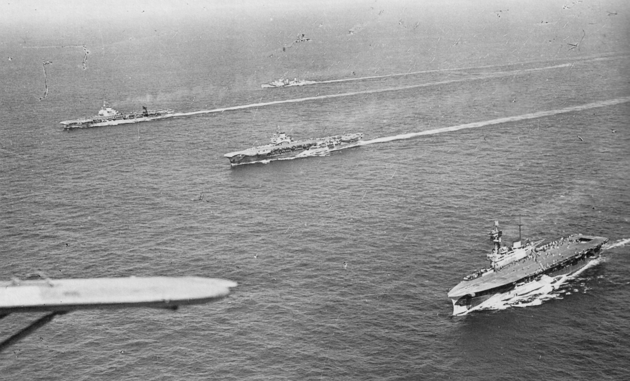 Preliminary movements 3 - 10 August 1942: Aerial view of some of the ships escorting the convoy. Nearest the camera is HMS EAGLE, then HMS INDOMITABLE and HMS VICTORIOUS and in the background are HMS FURIOUS and HMS ARGUS.