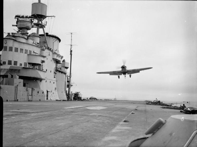 A Hawker Sea Hurricane of 885 Squadron, Fleet Air Arm flying over the flight deck of HMS VICTORIOUS prior to landing after flying exercises.