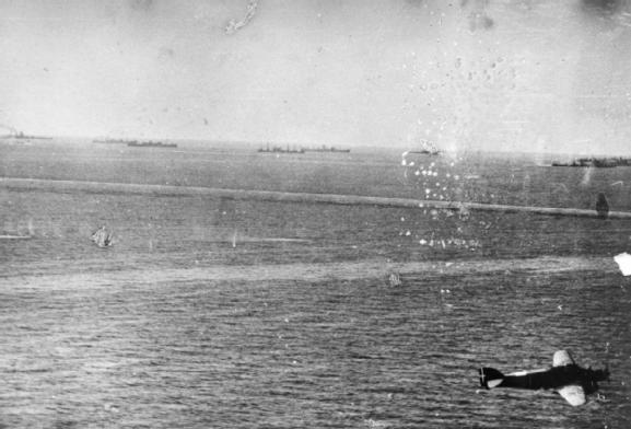 12 August: Air attacks: An Italian photograph of the convoy under attack. An Italian SM.79 torpedo bomber is in the right of the photograph.