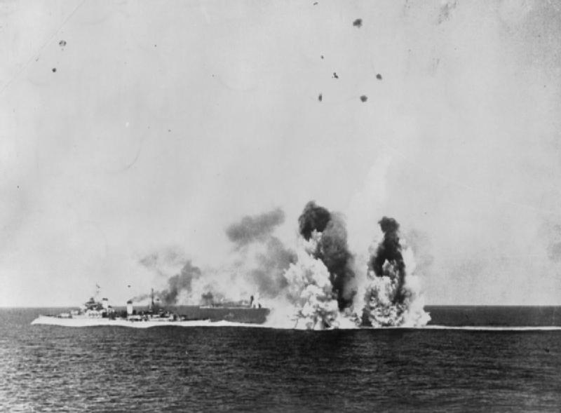 12 August: Evening Air and Submarine attacks: HMS KENYA under air attack on her return voyage to Gibraltar.