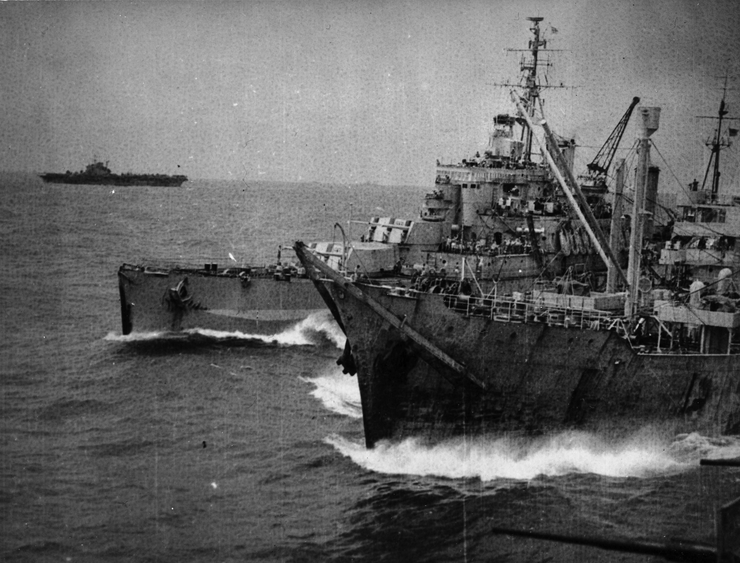 The oiler OLNA refuels HMS NEWFOUNDLAND with IMPLACABLE in the background.