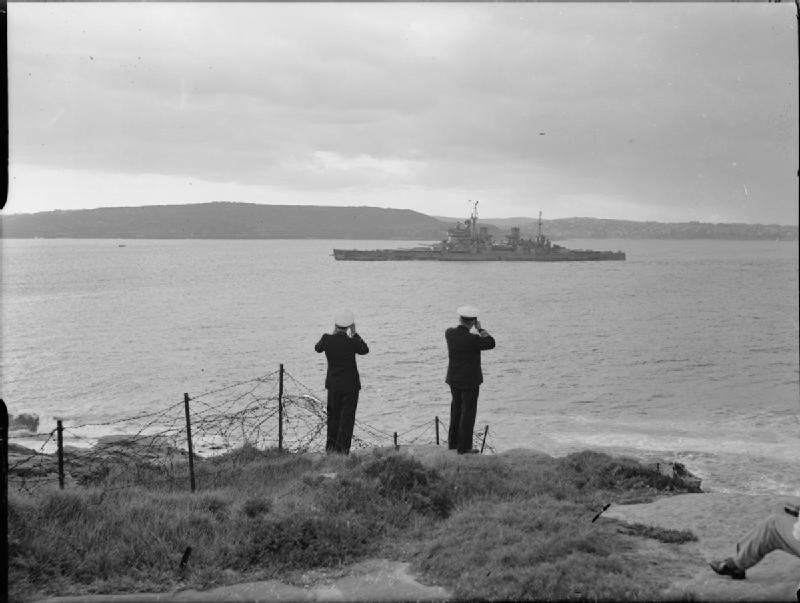Admiral Sir Bruce Fraser, GCB, KBE Commander in Chief British Pacific Fleet (right) watching his old flagship HMS DUKE OF YORK as she entered Sydney Harbour, Australia.