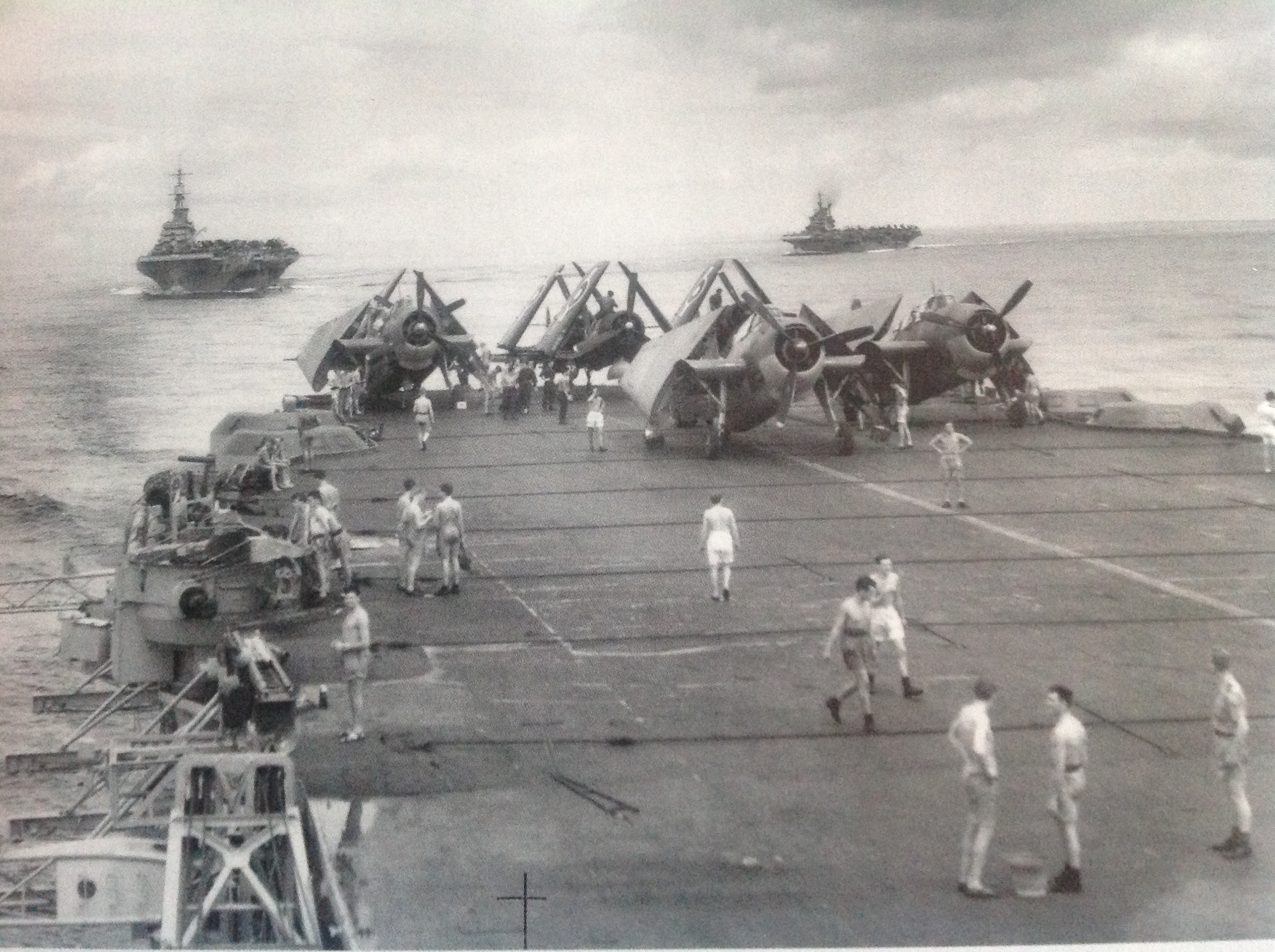 HMS VICTORIOUS and IMPLACABLE seen above Avenger and Chance-Vought Corsair aircraft of HMS FORMIDABLE as the ships turned into position.