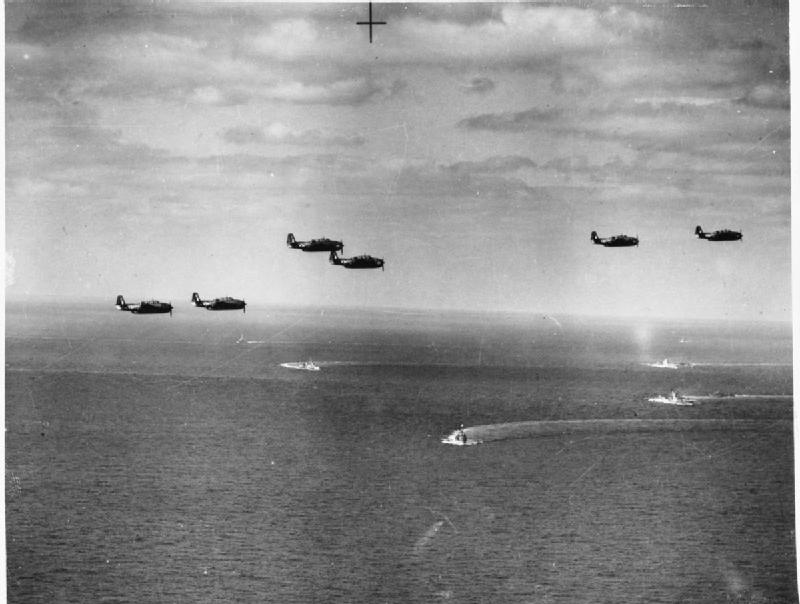 Avengers in formation above units of Task Force 57's formation.