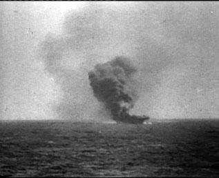 Indefatigable burns after the kamikaze impact.