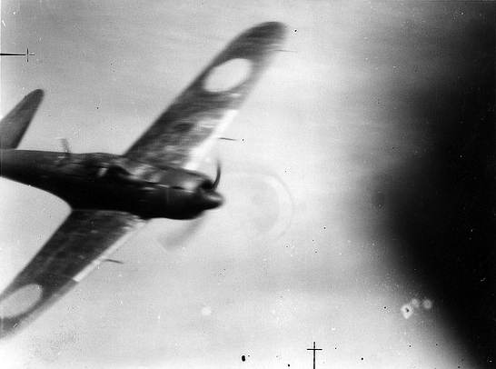 "A Japanese ""Zeke"" kamikaze aircraft captured in its final death-dive on to the deck of HMS Victorious."