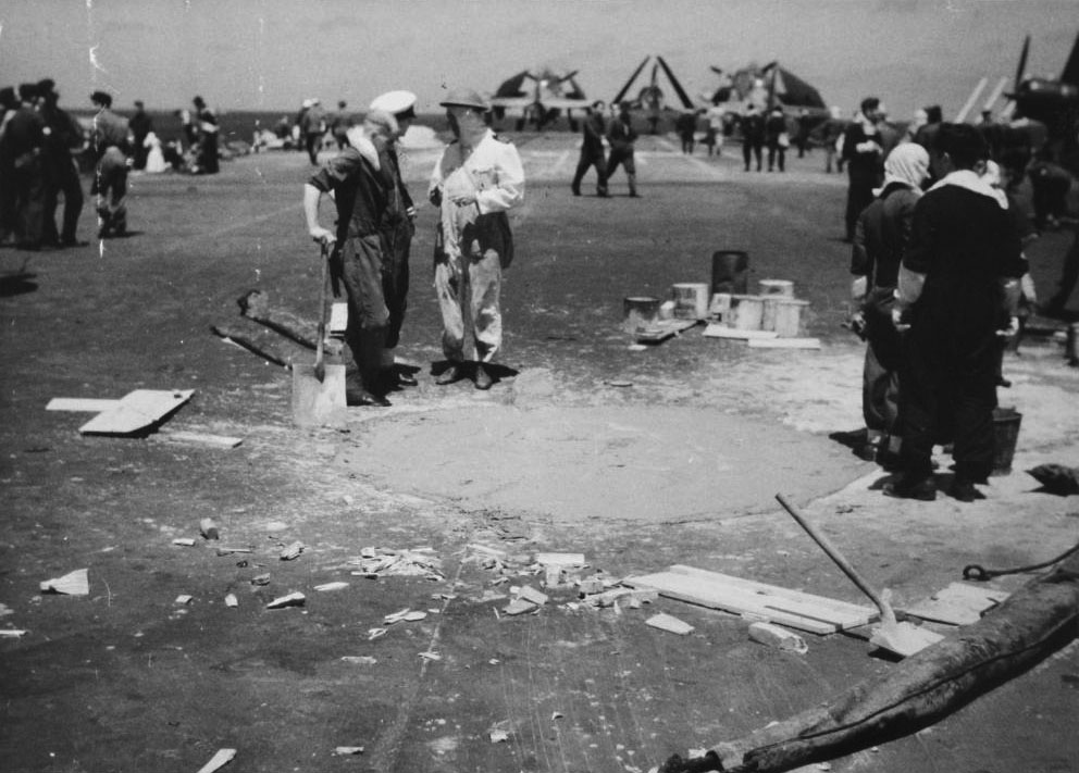 Rapid-set concrete and timber-infill made good the 'dent' in HMS Formidable's armoured flight deck within hours of the direct hit by a 500lb bomb-wielding kamikaze.