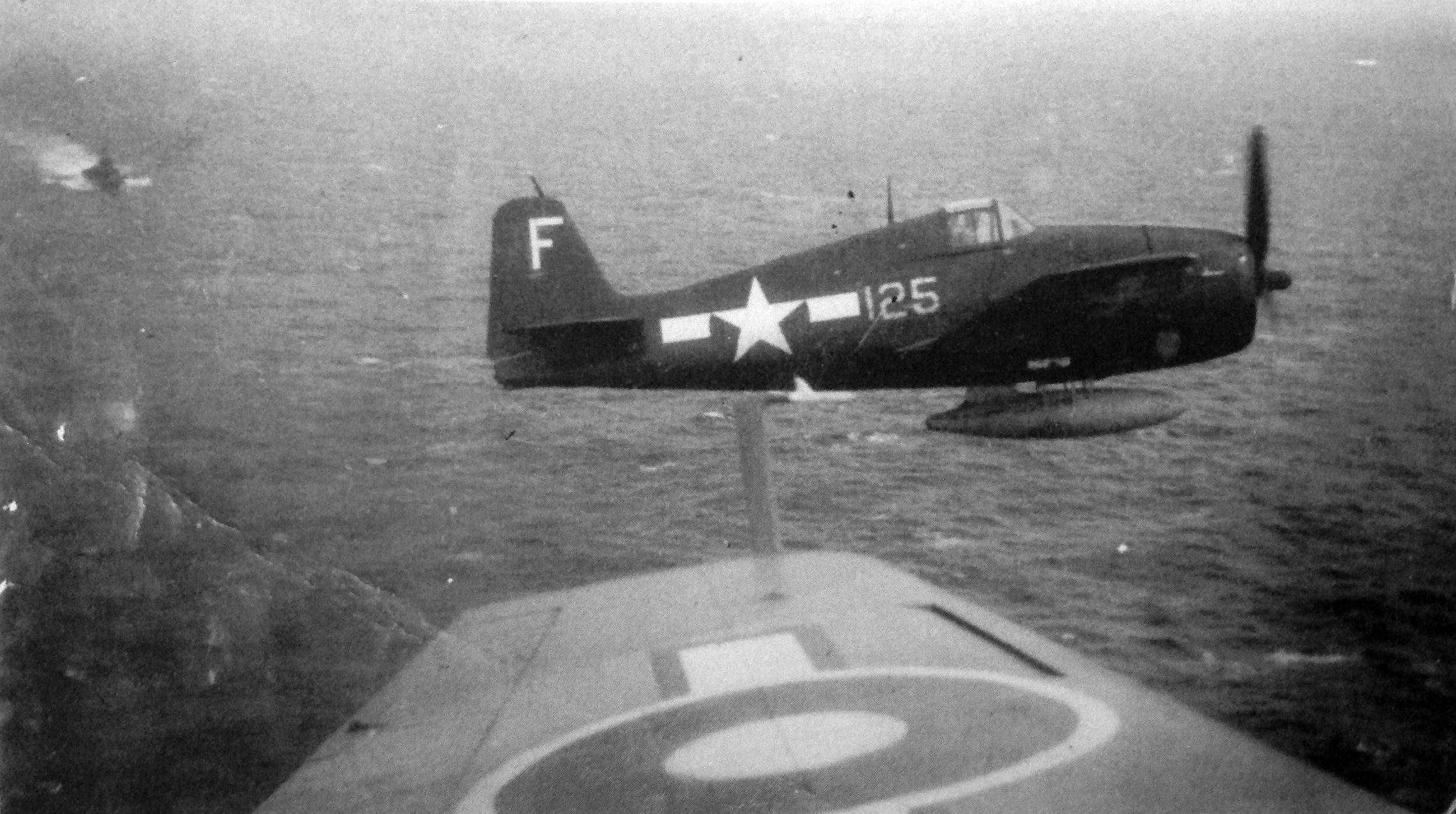 Insurmountable hurdle ... An FAA Avenger in close company with a USN Hellcat in the last weeks of the war when the two fleets worked together. Some political sectors in both the UK and US saw such close operation as something to be avoided, at any tactical cost.