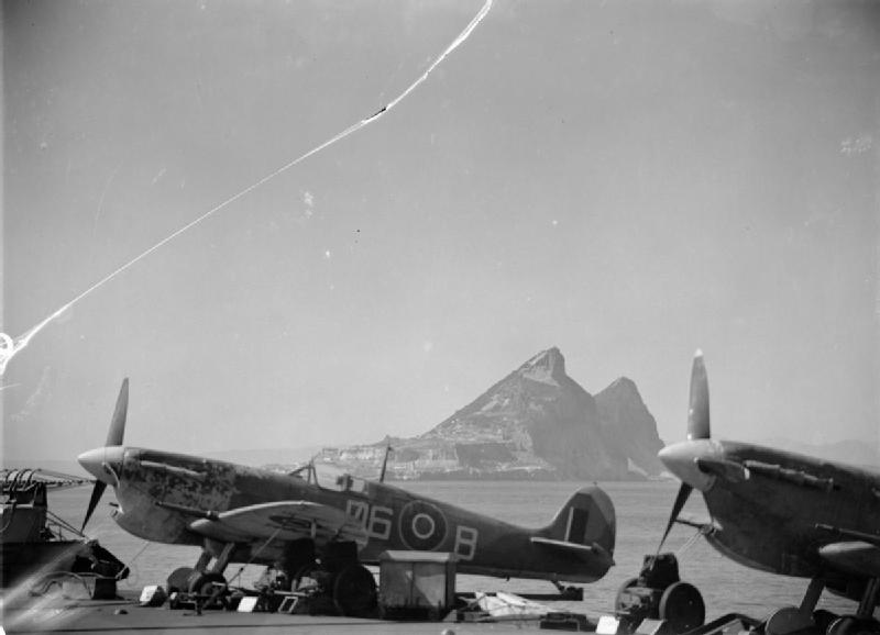 The Rock of Gibraltar viewed between two Supermarine Seafire aircraft of No 885 Squadron Fleet Air Arm on board HMS FORMIDABLE.