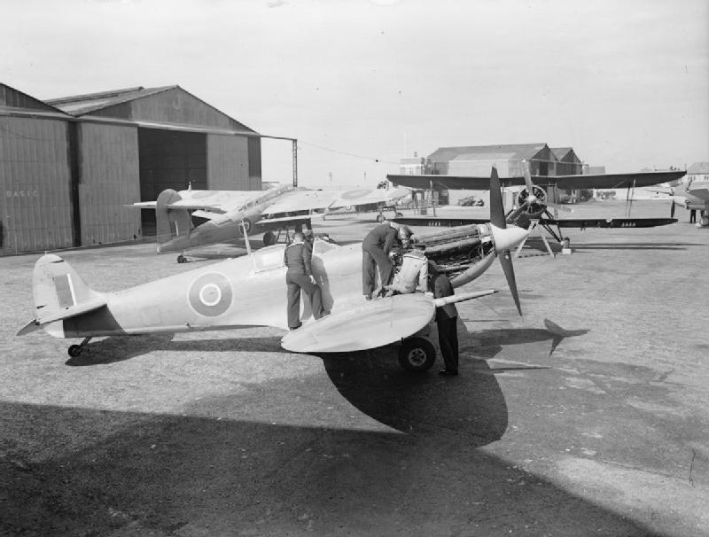 A maintenance crew at work on a Supermarine Seafire at RNAS Lee-on Solent.