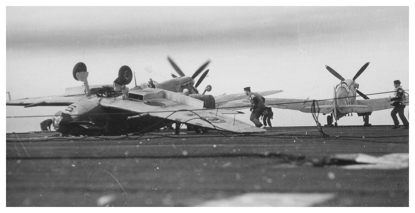 A Seafire ends up on its back after a botched landing aboard HMS ATTACKER in the fickle winds off Salerno, 1943