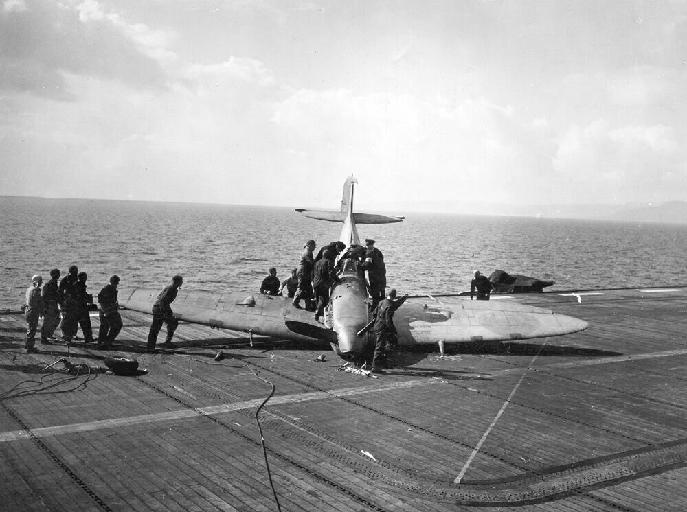 A Seafire after taking the crash barrier aboard the escort carrier HMS RAVAGER.