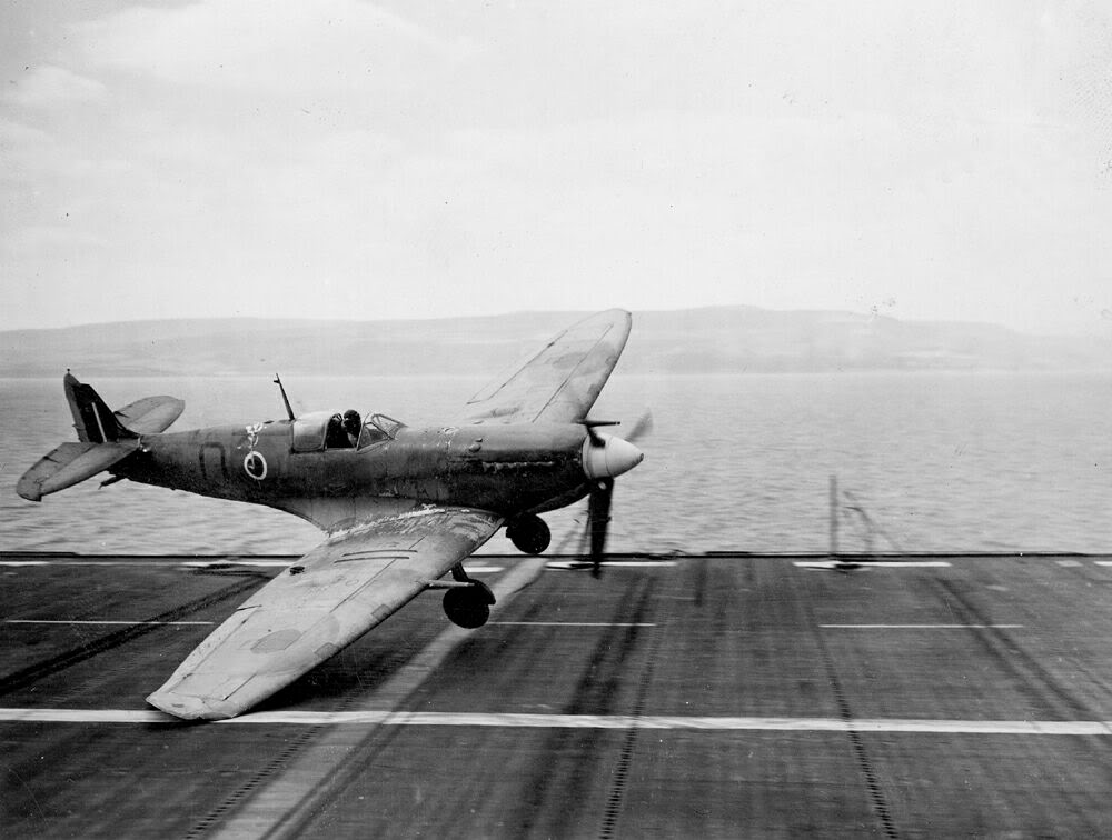 "A Seafire trapped by its characteristic ""float"" upon touch-down about to go into the crash barrier aboard HMS RAVAGER."