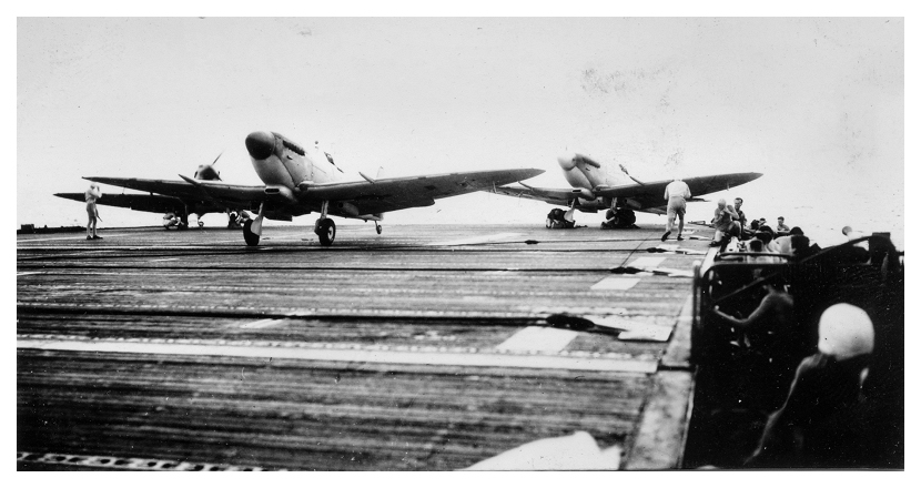 Seafires take off from the deck of the escort carrier HMS STALKER