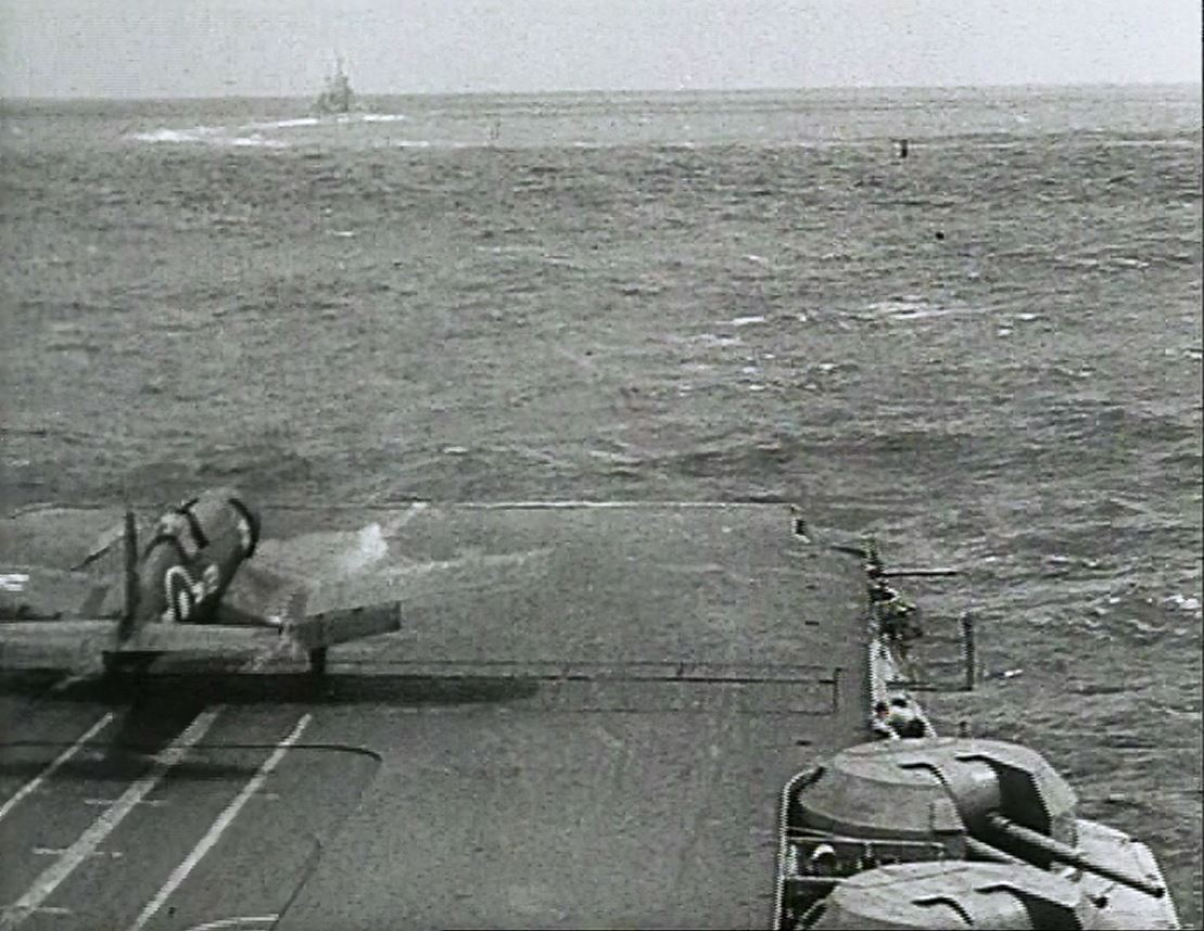 A Corsar on its take-off run aboard HMS ILLUSTRIOUS.